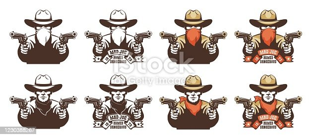 istock Cowboy bandit from the wild west with guns in his hands 1230388267