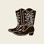 istock Cowboy boots silhouette in retro style 1145885473