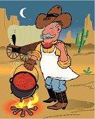 Cowboy Chef Making Chili Over Campfire Near Chuckwago