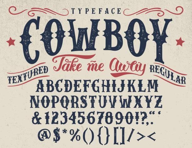 Cowboy handcrafted retro textured typeface Cowboy, take me away. Handcrafted retro textured regular typeface. Vintage font design, handwritten alphabet. Original handmade textured lettering americana stock illustrations