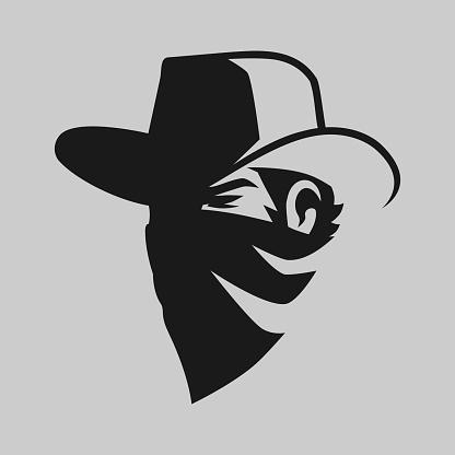 Cowboy outlaw symbol on gray backdrop