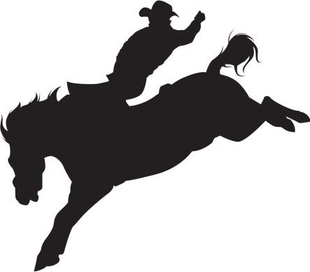 Cowboy Riding A Bucking Bronco Silhouette Stock ...