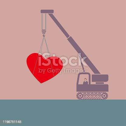 istock Crane lifts heart shaped symbol. 1196751145