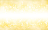 A creative glittery golden background. merry christmas vector Illustration .There are golden bubbly glittery circles in small, medium and large sizes overlapping and merging in the golden background.  The central horizontal band is highlighted in  a lighter tone. Copy space, background. Romantic, soft, hues. New Year celebration background.