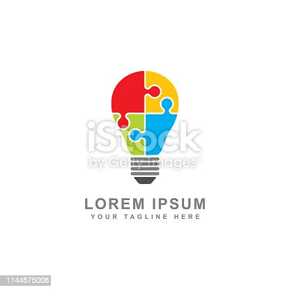 Creative puzzle light bulb concept isolated white background