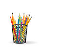 Black pencil bucket with color pencils and copy space for your messages.