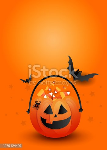 istock Creative vertical poster mockup. Halloween candy pumpkin bag with scary black bats on an orange background with copyspace. 1279124429