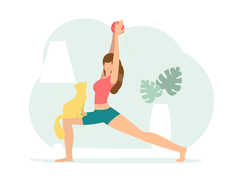 Crescent lunge pose. Woman doing Yoga with cat