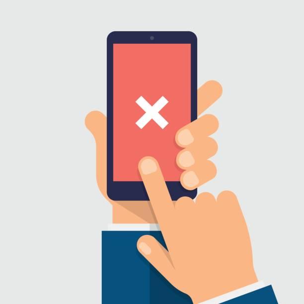 cross mark on smart-phone screen. hand holding smart phone. finger on mobile device screen. modern flat vector illustration. - hand holding phone stock illustrations