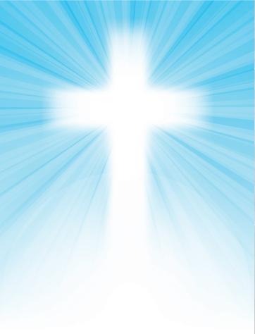 cross on blue sky, with sun rays