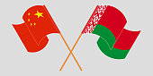 Crossed and waving flags of Belarus and China. Vector illustration