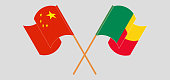 Crossed and waving flags of Benin and China. Vector illustration