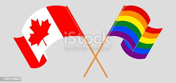 istock Crossed and waving flags of Canada and LGBTQ 1285109943