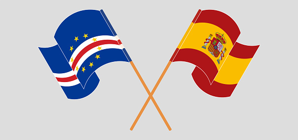 Crossed and waving flags of Cape Verde and Spain