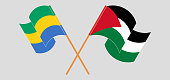 Crossed and waving flags of Gabon and Palestine. Vector illustration