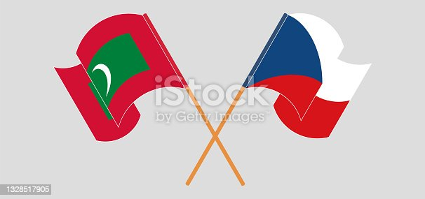 istock Crossed and waving flags of Maldives and Czech Republic 1328517905