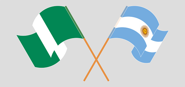 Crossed and waving flags of Nigeria and Slovakia