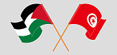 Crossed and waving flags of Palestine and Tunisia. Vector illustration