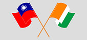 Crossed and waving flags of Taiwan and Republic of Ivory Coast. Vector illustration