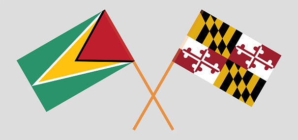 Crossed flags of Guyana and the State of Maryland. Official colors. Correct proportion