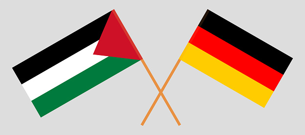 Crossed flags of Palestine and Germany