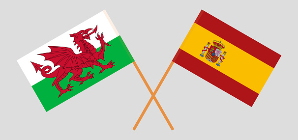Crossed flags of Wales and Spain. Official colors. Correct proportion
