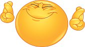 Emoticon hoping hard with crossed fingers