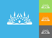 Crown  Flat Icon on Blue Background. The icon is depicted on Blue Background. There are three more background color variations included in this file. The icon is rendered in white color and the background is blue.