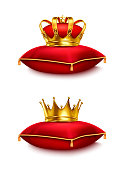 Two golden crowns on red ceremonial pillows isolated on white background realistic vector illustration