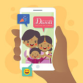 Cartoon Indian family having video call using smartphone. Video chat concept art. A hand holding device with people on screen. Flat vector illustration.