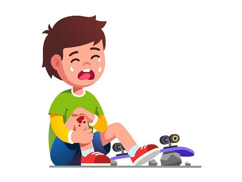 Crying boy kid fallen off skateboard. Child skater