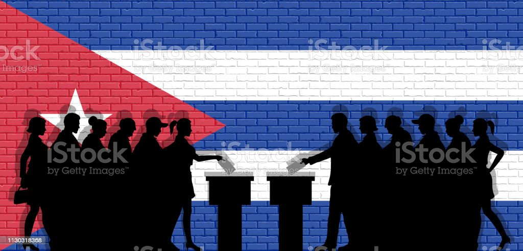 Cuban voters crowd silhouette in election with Cuba flag graffiti in...