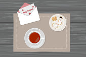 Vector illustration of cup of tea, gingerbread and envelope on napkin