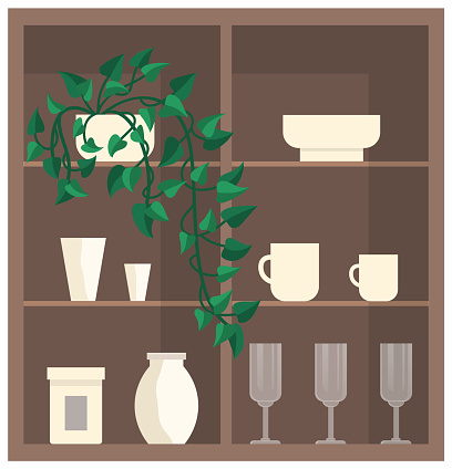 Cupboard with glass and porcelain dishes. Wooden furniture, interior elements with crockery, plants