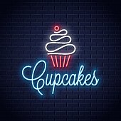 cupcake neon logo on wall vector background 10 eps