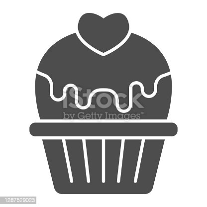 istock Cupcake with heart and glaze solid icon, valentine day concept, muffin with icing sign on white background, cake with love icon in glyph style for mobile concept. Vector graphics. 1287529023