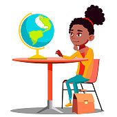 Curious Girl Sitting At The Table And Looking At Globe Vector. Isolated Illustration