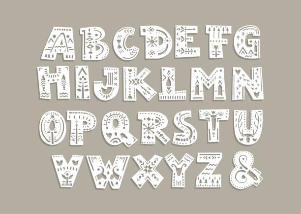 schneiden sie briefe mit skandinavischen mustern für eine laser-schneiden-vorlage von papier und vinyl. - laservorlagen stock-grafiken, -clipart, -cartoons und -symbole