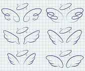 Cute angel wings with halo set. Cartoon vector sketch icons isolated on notebook page.