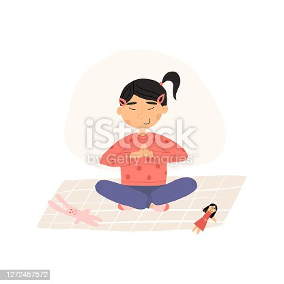 istock Cute Asian girl put down a toys and meditates in lotus or padmasana pose with her hands folded at the heart, plant and soft bear toy nearby. Vector hand-drawn isolated illustration. 1272457572