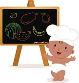 Cute baby chef. Baby boy with board.