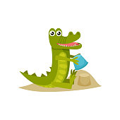 Cute baby crocodile building sand castle at the beach. Funny humanized animal. Cartoon character of green predatory reptile. Graphic element for children book. Isolated vector icon in flat style.