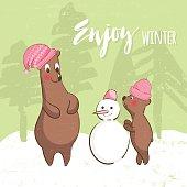 Cute Bears make a snowman.