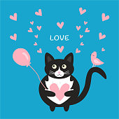 Cute black cat with a pink heart in his paws, a pink bird on his tail and a pink balloon. Love card for Valentine's Day.
