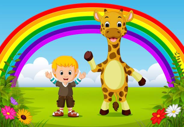 süsser boy und giraffen im park mit regenbogen-szene - giraffenkostüm stock-grafiken, -clipart, -cartoons und -symbole