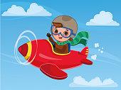 Cute boy pilot flies on a red plane.