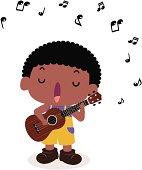 Cute boy playing guitar(ukulele) and singing