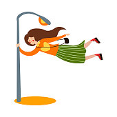 Cute brown-haired girl blows by the wind. She holds on to a pole. Isolated vector icon illustration on white background in cartoon style.