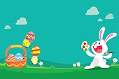 cute bunny and chicks preparing easter eggs