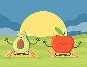 istock Cute cartoon avocado and apple characters meditating at sunset 1323464791